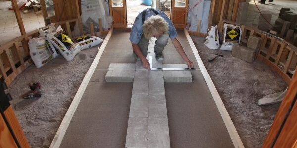 Henry Wiersma installs the Compressed EarthBlock Floor